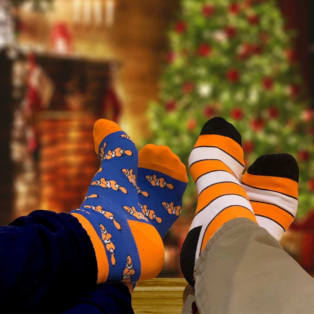 Clownfish Christmas socks by the fire